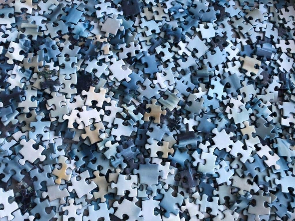 A box full of jigsaw puzzle pieces
