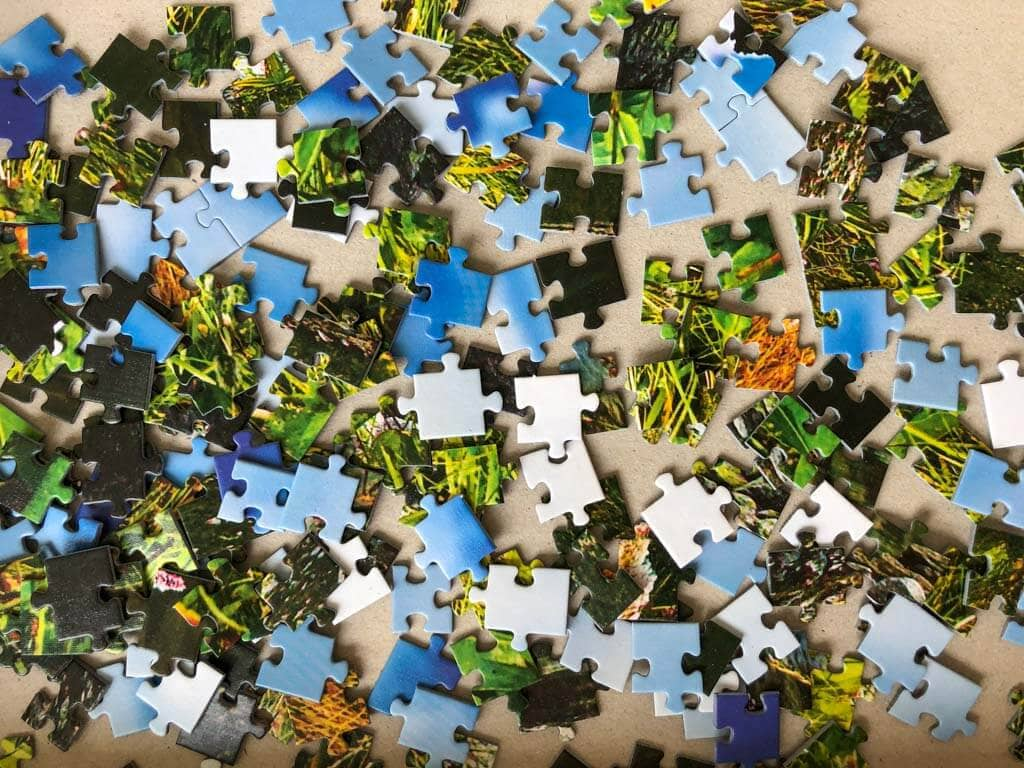 Colorful jigsaw puzzle pieces in a box