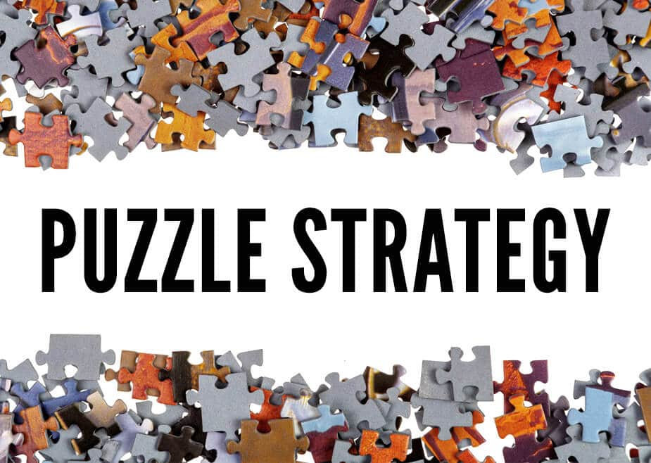 "Puzzle pieces with text overlay ""Puzzle Strategy"""