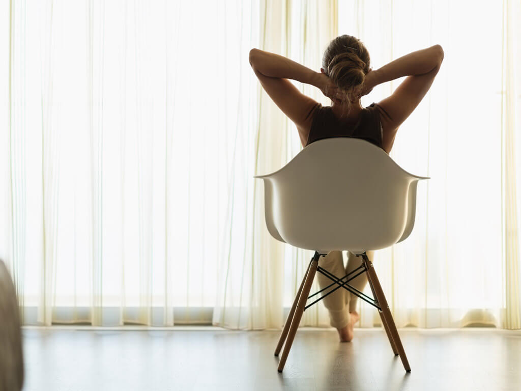 A woman relaxing on a chair