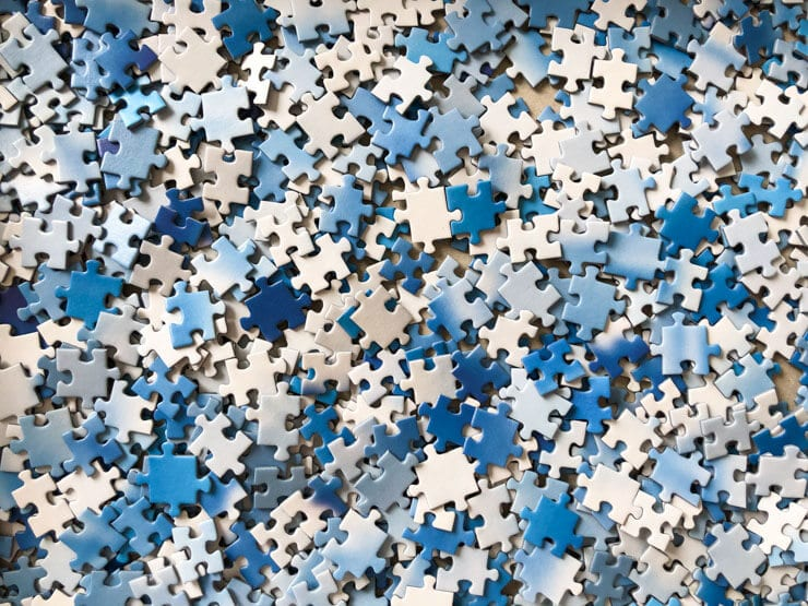 Blue and white jigsaw puzzle pieces