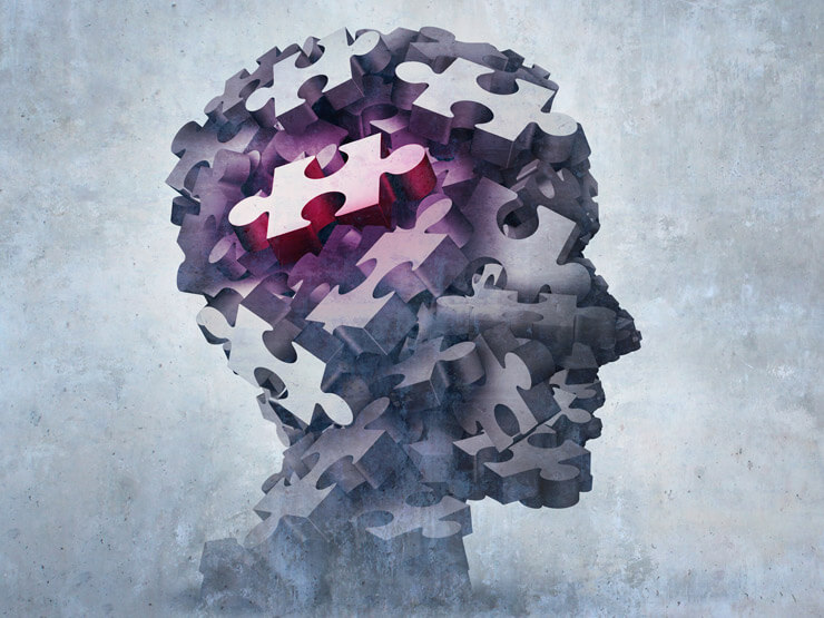 An abstract head made up of puzzle pieces