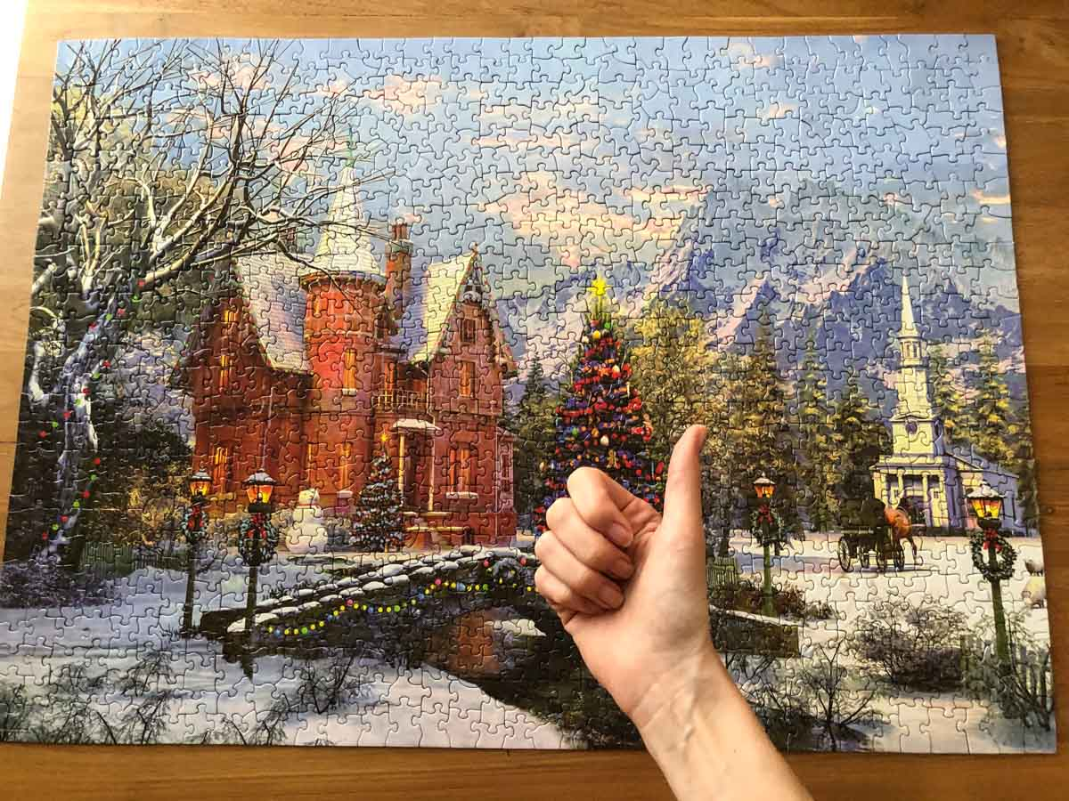 Photo of a finished Christmas puzzle with a thumb up