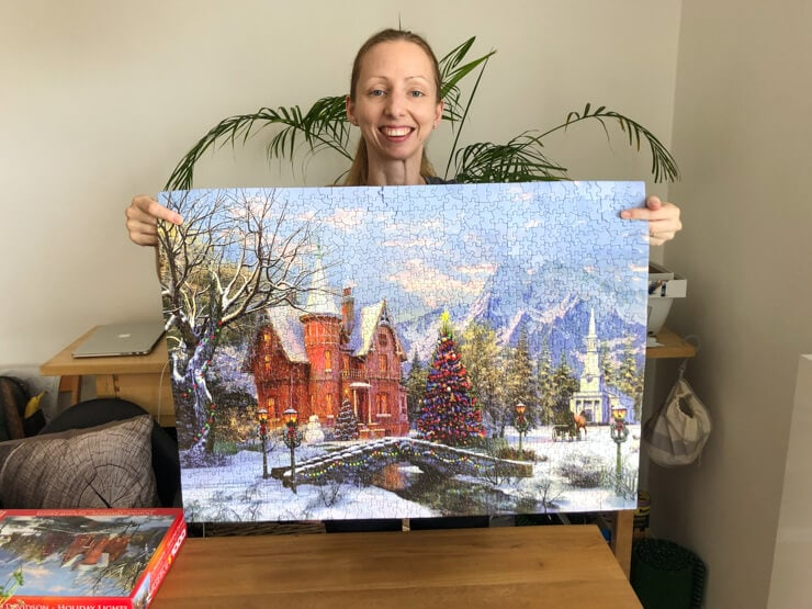Veronika with a finished Christmas jigsaw puzzle