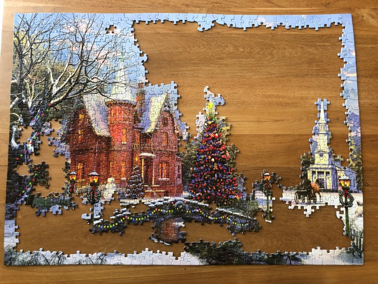 Half-finished puzzle with a Christmas theme