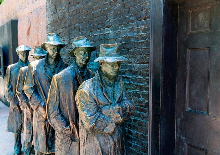 Sculptures of men waiting in a bread line during the Great Depression - part of the FDR Memorial in Washington, DC